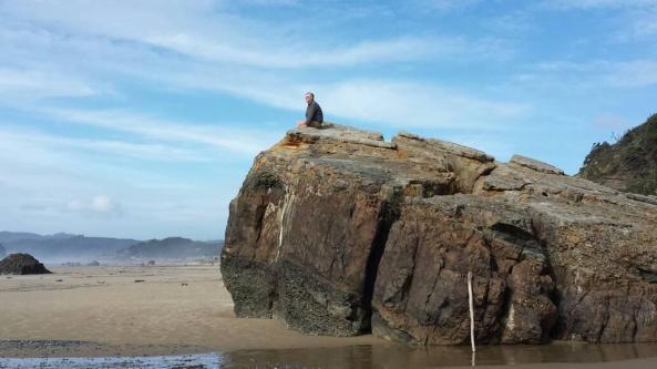 Jeff sitting atop rock